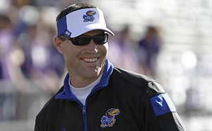 KU interim head football coach, Clint Bowen, watches the Jayhawks during drills before the game against the Kansas State Wildcats in Manhattan.