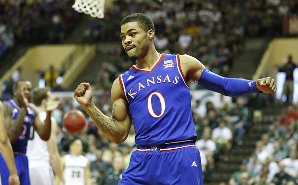 Kansas guard Frank Mason III (0) pumps his fist after a bucket and a Michigan State foul during the first half on Sunday, Nov. 30, 2014 at the HP Field House in Kissimmee, Florida.