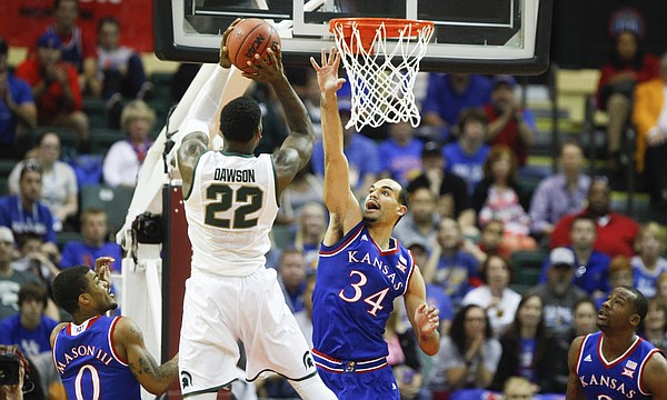 Kansas forward Perry Ellis (34) defends against a shot from Michigan State guard/forward Branden Dawson (22) during the first half on Sunday, Nov. 30, 2014 at the HP Field House in Kissimmee, Florida. Also pictured are KU guard Frank Mason, left, and forward Cliff Alexander.