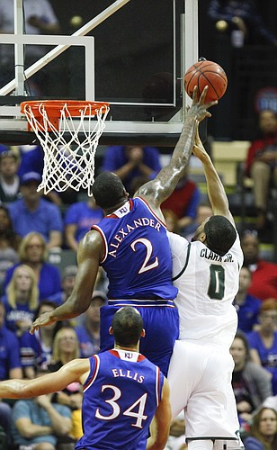 Kansas forward Cliff Alexander (2) rejects a shot from Michigan State forward Marvin Clark Jr. (0) during the first half on Sunday, Nov. 30, 2014 at the HP Field House in Kissimmee, Florida.