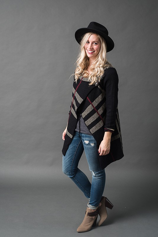 Elizabeth Kennedy's casual winter outfit: hat, sweater, jeans from Weaver's; ankle boots from Foxtrot.