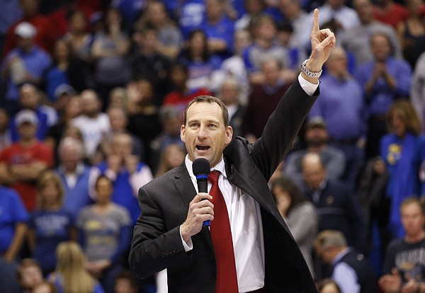 Newly-hired Kansas head football coach David Beaty is introduced to the Allen Fieldhouse crowd during halftime of the JayhawksÕ game against Floriday on Friday, Dec. 5, 2014. Beaty is the 38th head coach in the programÕs history.