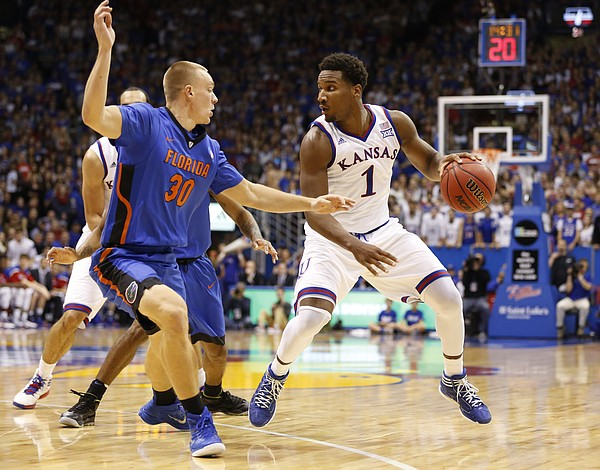 Kansas guard Wayne Selden Jr. (1) is defended by Florida forward Jacob Kurtz (30) during the first on Friday, Dec. 5, 2014 at Allen Fieldhouse.