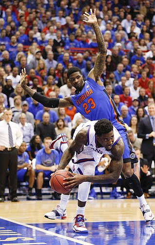 Kansas forward Jamari Traylor (31) tries to get around Florida forward Chris Walker (23) during the first on Friday, Dec. 5, 2014 at Allen Fieldhouse.