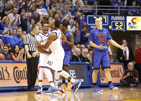 Kansas guards Devonte Graham and Wayne Selden celebrate a forced turnover against the Gators before Florida forward Jacob Kurtz (30) during the second half on Friday, Dec. 5, 2014 at Allen Fieldhouse.