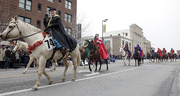 Ladies with the Saralee Garren-Victorian Ladies Club, Oskaloosa, ride in the annual Lawrence Old-Fashioned Christmas Parade.