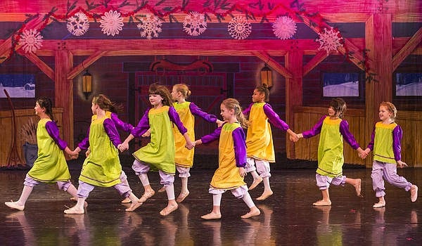 """Dancers portraying the schoolchildren practice a scene during a dress rehearsal for the Lawrence Arts Center's """"A Kansas Nutcracker"""" in this 2014 file photo."""