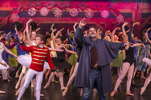 Ric Averill, who portrays Hugh Cameron, leads performers through the finale during a dress rehearsal for the upcoming Kansas Nutcracker, Tuesday, Dec. 9, 2014 at the Lawrence Arts Center.