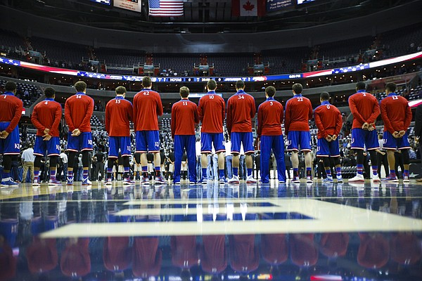 The Jayhawks stand for the National Anthem prior to tipoff against Georgetown on Wednesday, Dec. 10, 2014 at Verizon Center in Washington D.C.