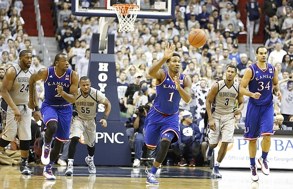 Kansas guard Wayne Selden Jr. (1) pushes the ball up the court on a breakaway during the second half on Wednesday, Dec. 10, 2014 at Verizon Center in Washington D.C.