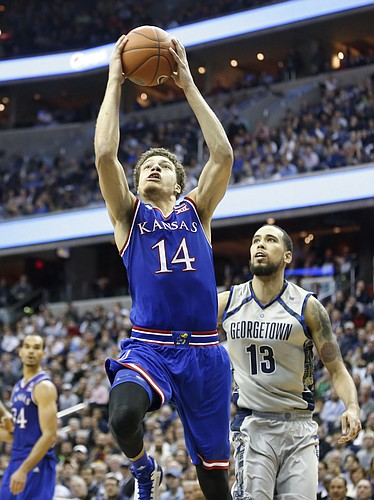 Kansas guard Brannen Greene (14) heads to the bucket past Georgetown forward Paul White (13) during the second half on Wednesday, Dec. 10, 2014 at Verizon Center in Washington D.C.