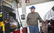 Mitch Reiber, Olathe, fills his car up with gas at the Zarco station at 1500 E. 23rd St. on Friday, Dec. 12. Reiber was filling up for a price of $2.34 for regular unleaded.