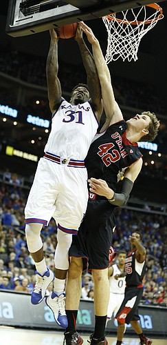 Kansas forward Jamari Traylor (31) gets inside for a bucket and a foul from Utah forward Jakob Poeltl (42) during the second half on Saturday, Dec. 13, 2014 at Sprint Center