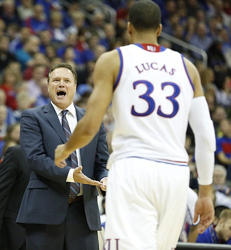 Kansas head coach Bill Self questions a play by forward Landen Lucas during the second half on Saturday, Dec. 13, 2014 at Sprint Center
