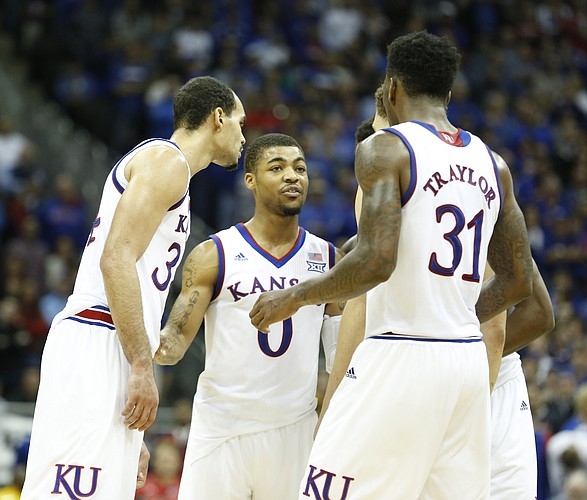 Kansas guard Frank Mason III (0) huddles the Jayhawks before free throw attempts by Brannen Greene with seconds to play during the second half on Saturday, Dec. 13, 2014 at Sprint Center