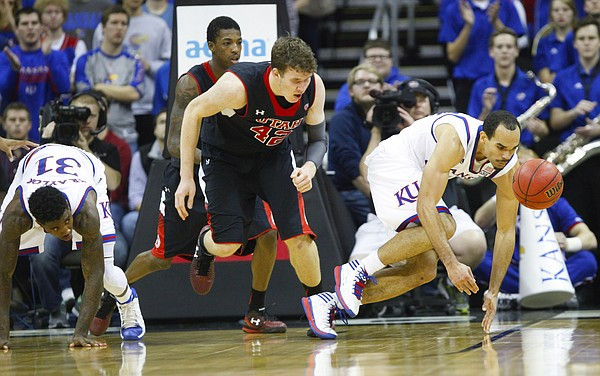Kansas forward Perry Ellis (34) chases down a loose ball lost by Utah forward Jakob Poeltl (42) during the second half on Saturday, Dec. 13, 2014 at Sprint Center