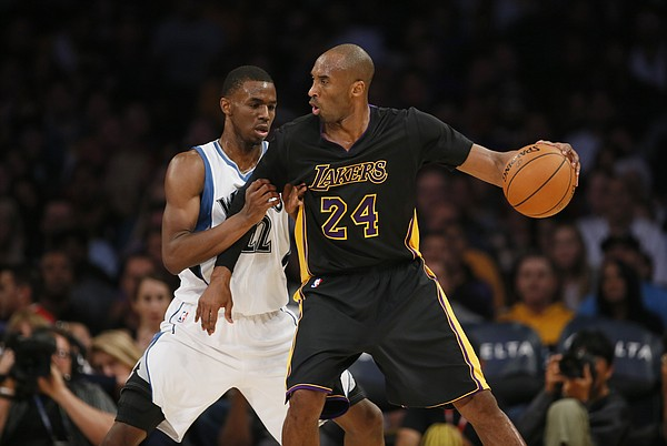 Minnesota Timberwolves' Andrew Wiggins defends against Los Angeles Lakers' Kobe Bryant during the first half of an NBA basketball game Friday, Nov. 28, 2014, in Los Angeles