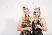 From left, Elizabeth and Emily Kennedy sport New Year's Eve dresses with gold and black sequins from Francesca's.