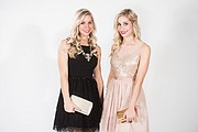 "Elizabeth Kennedy, left, wears a ""little black dress"" with chunky statement necklace, and Emily Kennedy sports a light-pink dress with tulle and netting that makes it unique. Both dresses from Francesca&squot;s can be worn on New Year&squot;s and other formal occasions throughout the year."