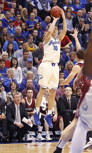Kansas guard Sviatoslav Mykhailiuk (10) shoots in a three-point basket in the first-half against the Lafayette Leopards Saturday, Dec. 20, 2014 at Allen Fieldhouse.