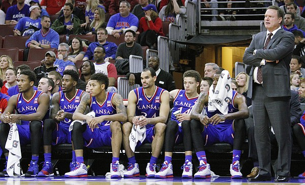 Kansas coach Bill Self and members of the team watch in the closing minutes of a 77-52 loss to the Temple Owls Monday at the Wells Fargo Center in Philadelphia, PA.