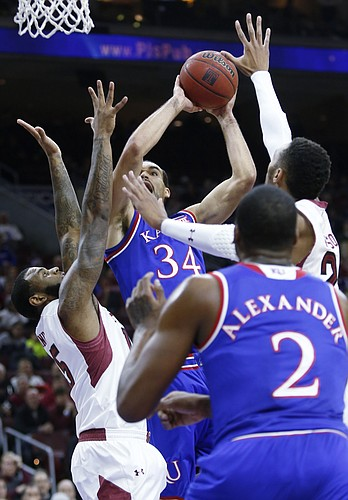Kansas forward Perry Ellis (34) tries to power his way to the goal past Temple defenders against the Owls Monday at the Wells Fargo Center in Philadelphia, PA.