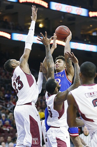 Kansas guard Kelly Oubre, Jr. is surrounded by Temple defenders during the Jayhawk's game against the Owls Monday at the Wells Fargo Center in Philadelphia, PA.