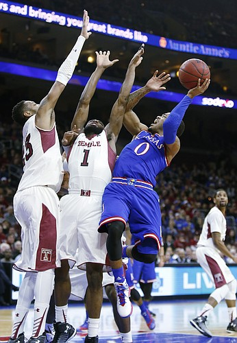 Kansas guard Frank Mason III, drives against Temple defenders in the Jayhawk's loss to the Temple Owls Monday at the Wells Fargo Center in Philadelphia, PA.