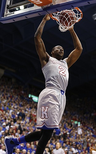 Kansas forward Cliff Alexander (2) delivers a dunk on a lob pass during the second half on Tuesday, Dec. 30, 2014 at Allen Fieldhouse.
