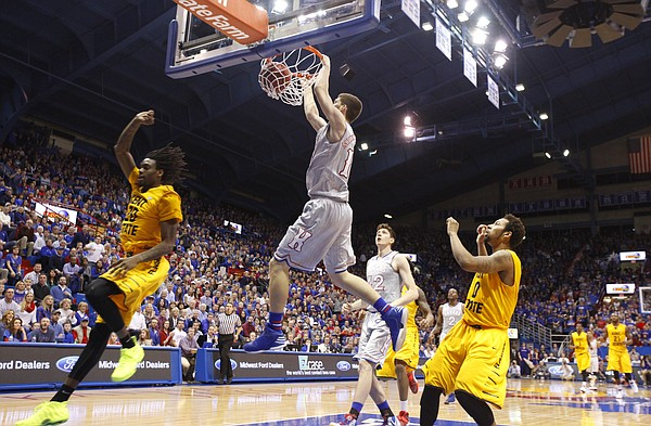 Kansas guard Sviatoslav Mykhailiuk (10) delivers a dunk on a breakaway during the second half on Tuesday, Dec. 30, 2014 at Allen Fieldhouse.