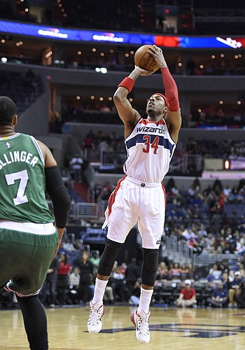 Washington Wizards forward Paul Pierce (34) takes a shot against Boston Celtics forward Jared Sullinger (7) during the first half of an NBA basketball game, Monday, Dec. 8, 2014, in Washington. (AP Photo/Nick Wass)