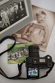 A portable means of digitizing old photographic prints and other documents can be achieved by using any digital camera. It's a convenient way to duplicate one-of-a-kind prints and save them for future generations.