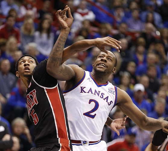 Kansas forward Cliff Alexander (2) battles in the paint with UNLV forward Christian Wood (5) during the first half against UNLV on Sunday, Jan. 4, 2015 at Allen Fieldhouse.