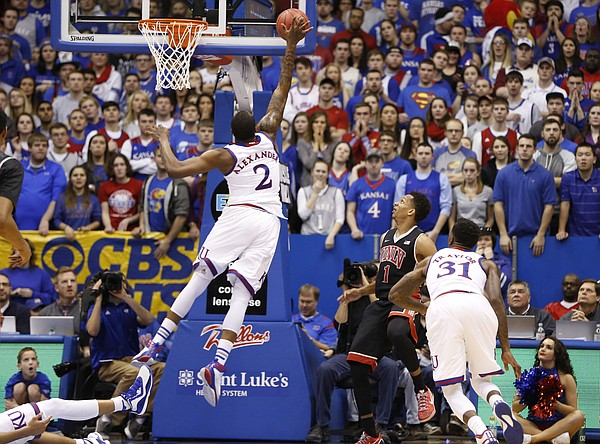 Kansas forward Cliff Alexander (2) blocks a shot by UNLV guard Rashad Vaughn (1) against the backboard during the second half on Sunday, Jan. 4, 2015 at Allen Fieldhouse.