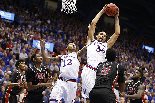 Kansas forward Perry Ellis (34) comes away with an offensive rebound during the second half against UNLV on Sunday, Jan. 4, 2015 at Allen Fieldhouse. Also pictured is KU guard Kelly Oubre.