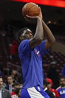 Philadelphia 76ers' Joel Embiid of Cameroon shoots the ball prior to the first half of an NBA basketball game against the Brooklyn Nets, Wednesday, Nov. 26, 2014, in Philadelphia. The Nets won 99-91. (AP Photo/Chris Szagola)