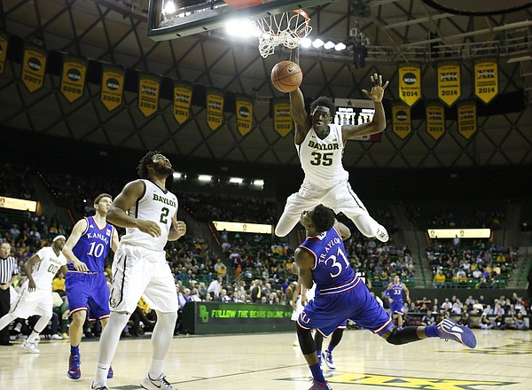 Baylor forward Johnathan Motley (35) bowls over Kansas forward Jamari Traylor (31) on a dunk during the first half on Wednesday, Jan. 7, 2014 at Ferrell Center in Waco, Texas. The dunk was called back and Motley was whistled for an offensive foul on the play.