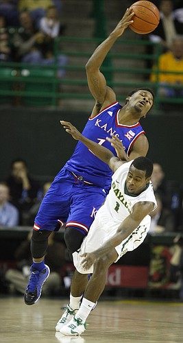 Kansas guard Wayne Selden Jr. (1) and Baylor guard Kenny Chery (1) collide at mid court while competing for a ball during the first half on Wednesday, Jan. 7, 2014 at Ferrell Center in Waco, Texas.