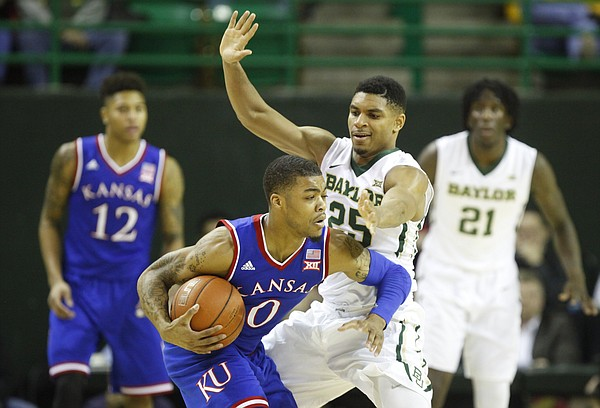 Kansas guard Frank Mason III (0) is hounded by Baylor guard Al Freeman (25) during the first half on Wednesday, Jan. 7, 2014 at Ferrell Center in Waco, Texas.