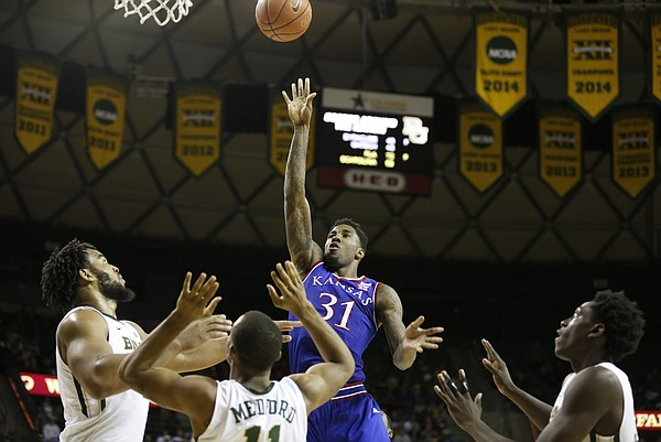 Kansas forward Jamari Traylor (31) puts up a floater amidst the Baylor defense during the second half on Wednesday, Jan. 7, 2014 at Ferrell Center in Waco, Texas.