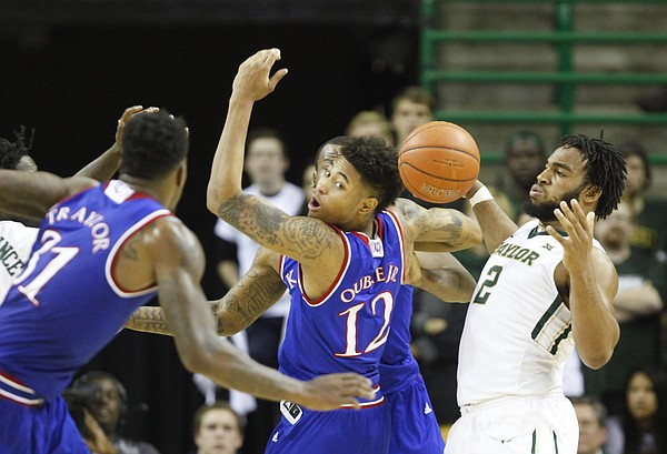 Kansas guard Kelly Oubre Jr. (12) tangles for a loose ball with Baylor forward Rico Gathers (2) during the second half on Wednesday, Jan. 7, 2014 at Ferrell Center in Waco, Texas.