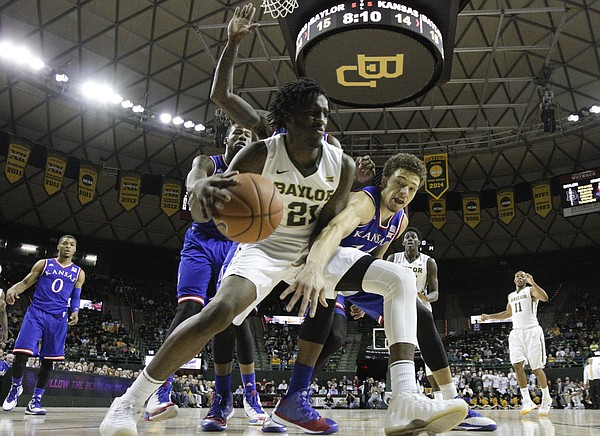 Kansas guard Brannen Greene defends Baylor forward Taurean Prince (21) under the bucket during the first half on Wednesday, Jan. 7, 2014 at Ferrell Center in Waco, Texas.