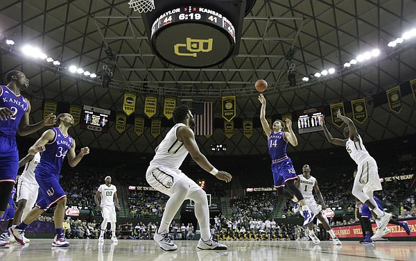 Kansas guard Brannen Greene (14) puts up a floater against Baylor with time winding down during the second half on Wednesday, Jan. 7, 2014 at Ferrell Center in Waco, Texas.