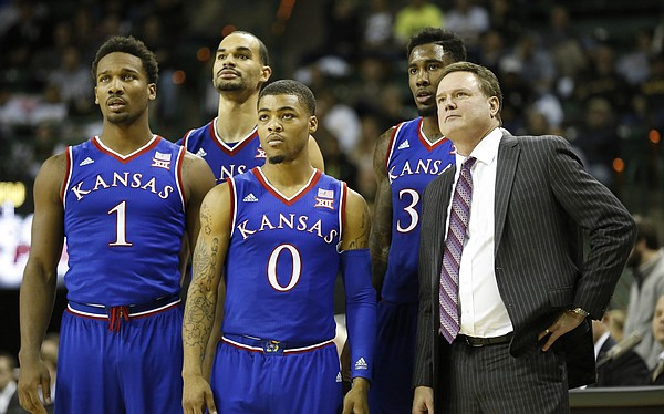 Kansas players, from left, Wayne Selden, Perry Ellis, Frank Mason and Jamari Traylor watch a pair of free throws from Kelly Oubre with head coach Bill Self after a flagrant foul by Baylor during the second half on Wednesday, Jan. 7, 2014 at Ferrell Center in Waco, Texas.