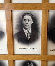 The photo of former KU student Joseph C. Liggett is among 129 photos of KU students and alumni who gave their lives in service to World War I, displayed on the sixth floor of the Kansas Union. Ray Liggett of Shawnee stumbled upon his great uncle's connection to KU and the war while doing genealogical research, but didn't previously know the Union was a memorial to him and other casualties. Ray Liggett said he learned that Joseph Liggett enlisted in October 1918 and died the next month. He was a member of KU's unit of the Student Army Training Corps but died in Lawrence in the influenza epidemic before he was ever deployed.