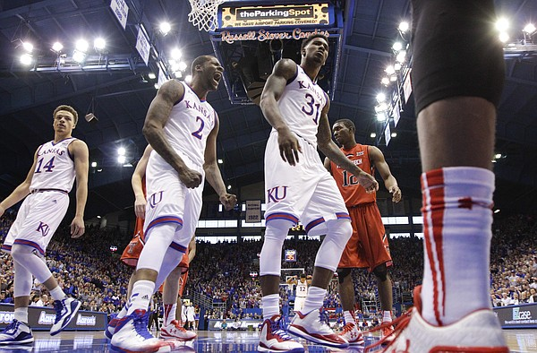 Kansas forward Cliff Alexander (2) celebrates a dunk by Kansas forward Jamari Traylor (31) as he casts a glare at at Texas Tech player during the first half on Saturday, Jan.10, 2015 at Allen Fieldhouse. At left is KU guard Brannen Greene.