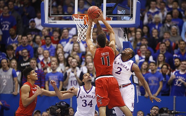 Kansas forward Cliff Alexander (2) gets a hand on a shot by Texas Tech forward Zach Smith (11) during the first half on Saturday, Jan.10, 2015 at Allen Fieldhouse. Also pictured are Kansas forward Perry Ellis (34) and Texas Tech center Isaiah Manderson.