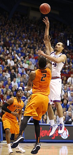 Kansas forward Perry Ellis (34) turns for a shot over Oklahoma State forward Le'Bryan Nash (2) during the first half, Tuesday, Jan. 13, 2015 at Allen Fieldhouse.