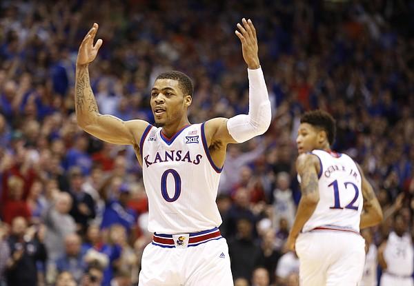 Kansas guard Frank Mason III (0) raises up his hands after  a lob pass to orward Cliff Alexander (2) for a dunk during the first half, Tuesday, Jan. 13, 2015 at Allen Fieldhouse.