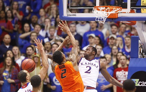 Kansas forward Cliff Alexander (2) swats a shot from Oklahoma State forward Le'Bryan Nash (2) during the first half, Tuesday, Jan. 13, 2015 at Allen Fieldhouse.